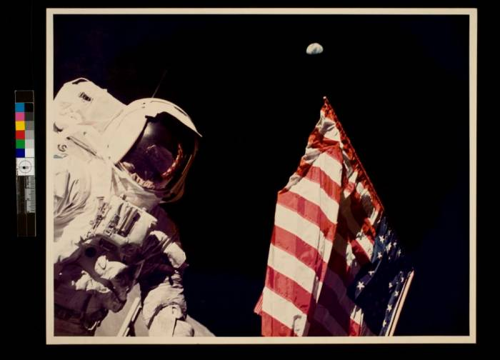 Schmitt with Flag and Earth Above {George Eastman Collection}